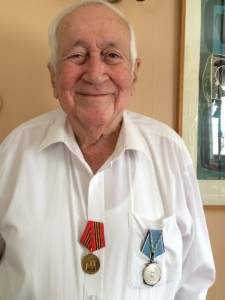 Bill Howard wearing the Ushakov medal (blue ribbon) and Russian 65th Anniversary Commemorative medal (red ribbon).