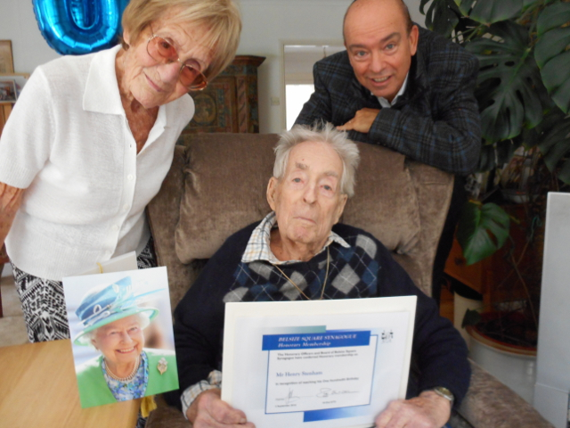 Henry Stenham celebrating his 100th birthday with community care coordinator Eve Herzov and cantor Paul Heller