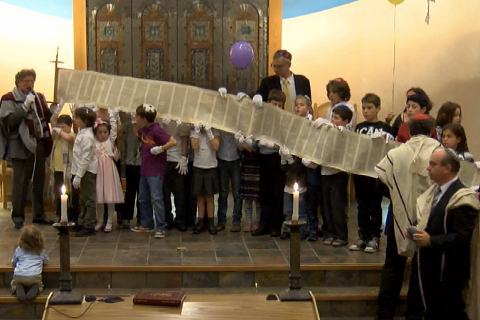 Children and scroll at Simchat Torah